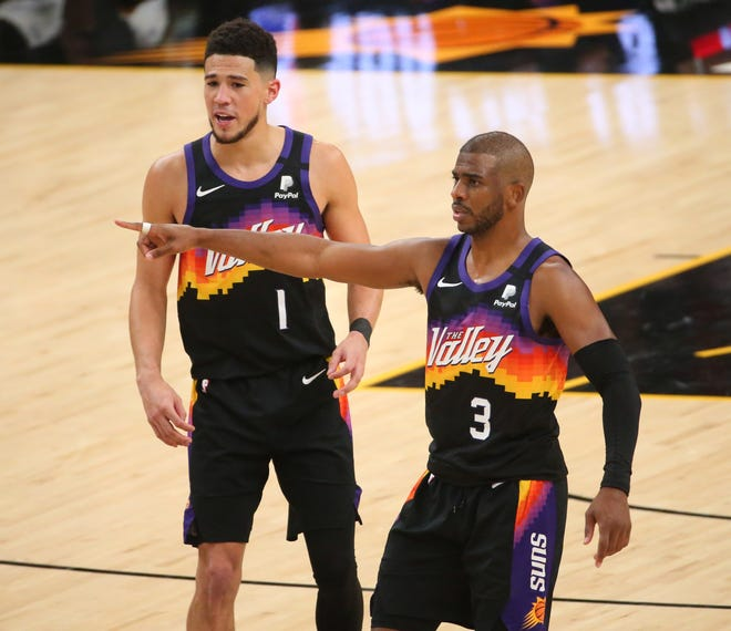 Phoenix Suns guards Chris Paul (3) and Devin Booker (1) defend against the Milwaukee Bucks during Game 1 of the NBA Finals at Phoenix Suns Arena July 6, 2021.