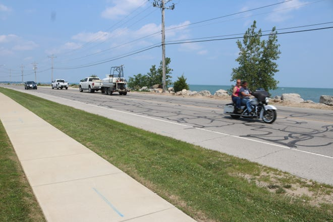 Plans to address erosion issues along Lakeshore Drive call for a portion of the road just west of Mr. Ed's in Port Clinton to be moved five to six feet south and putting paving hard surface overtop of the gap that would be created.
