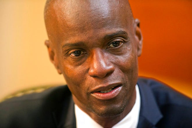 FILE - In this Feb. 7, 2020, file photo, Haiti's President Jovenel Moise speaks during an interview at his home in Petion-Ville, a suburb of Port-au-Prince, Haiti. Sources say Moise was assassinated at home, first lady hospitalized amid political instability. (AP Photo/Dieu Nalio Chery, File)
