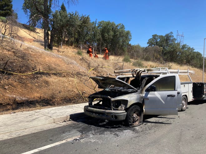 A truck going up Quartz Hill Road caught fire on Wednesday, July 7, 2021. Firefighters were able to quickly extinguish the flames after they reportedly spread to nearby vegetation.