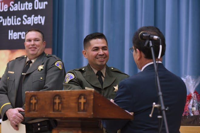 Deputy Luis Araujo was named Officer of the Year during the Knights of Columbus' 37th Public Safety Night at the St. Mary Parish Center. At right is David Rodriguez, trustee Knights of Columbus, Council 2268.