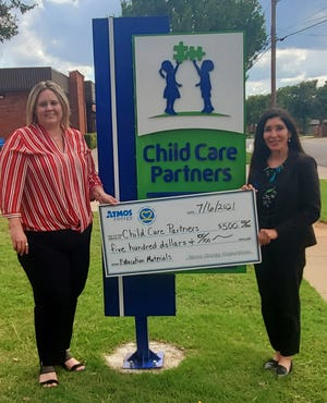 Keri Goins, Executive Director for Child Care Partners and Pam Hughes Pak, Manager of Public Affairs for Atmos Energy