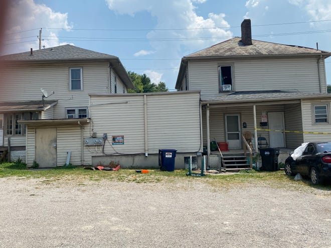 The home at 1525-and-a-half Maysville Avenue has been roped off as a fire that killed a 46-year-old woman is investigated.