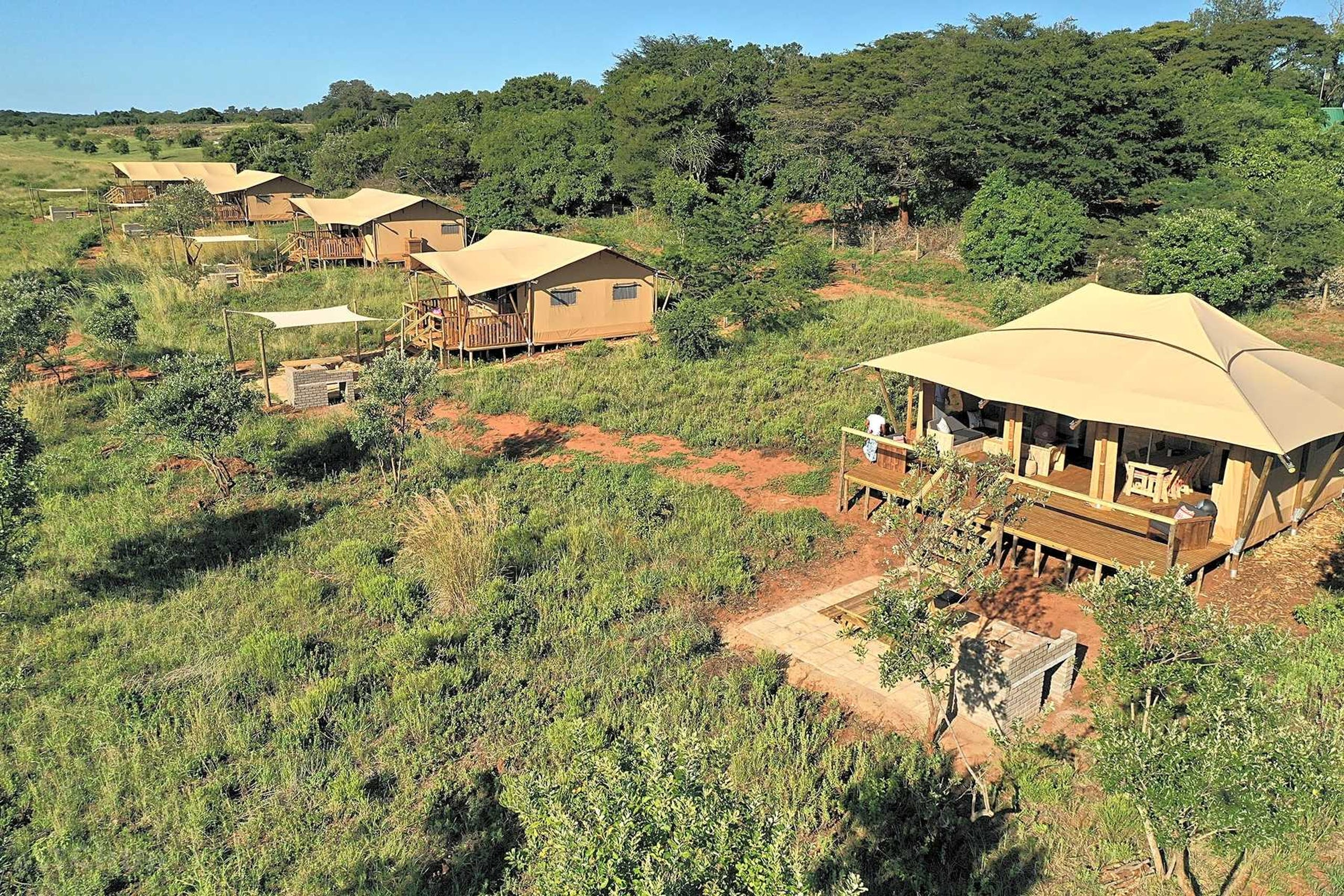 <strong>4. South Africa, Hluhluwe Bush Camp:</strong> Seeing wild animals in Africa sounds like a once-in-a-lifetime opportunity. Visitors here can do so while camping or glamping in one of the many tents at Bush Camp. A 25-minute drive away will lead to Hluhluwe-Imfolozi Park, the oldest proclaimed nature reserve in Africa. The park is known for its rhino conservation efforts. If you want to take a break from the heat, spend the day snorkeling the coral reefs at the Sodwana Bay in Isimangaliso Wetland Park.<br /> <strong>Price:</strong> Starting at $20.89 a night<br /> <strong>Park type:</strong> Tent, camper, RV, tipi, yurt