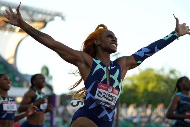 Sha'Carri Richardson celebrates after winning the women's 100 meter race during the U.S. Olympic trials.