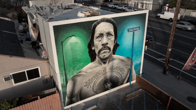 """The Danny Trejo mural by artist Levi Ponce was first painted in 2011 and was touched up in March. """"It was time for an upgrade,"""" Ponce talks about the mural located on the Mural Mile of Van Nuys Boulevard in Pacoima, California."""