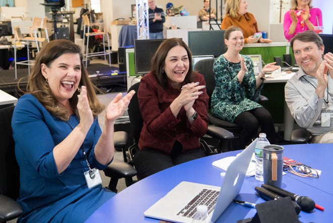 Nicole Carroll, Editor in Chief of USA TODAY, left, Maribel Perez Wadsworth, President of USA TODAY Network and Publisher of USA TODAY, center, and Chris Davis, Vice President and Executive Editor of Investigations, USA TODAY Network, celebrate during the announcement of the 2018 Pulitzer Prizes as Andie Dominick of The Des Moines Register was named as winner for Editorial Writing on April 16, 2018. Among USA TODAY Network properties, The Arizona Republic with the USA TODAY Network won for Explanatory Reporting for The Wall, The Cincinnati Enquirer won for Local Reporting on the heroin epidemic, and Andie Dominick of The Des Moines Register won for Editorial Writing.