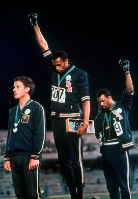 During the 1968 Summer Olympics in Mexico City, American sprinters Tommie Smith and John Carlos took the medal stand and raised a black-gloved fist during the playing of the national anthem. Smith had just won gold and set a world record of 19.83 seconds in the 200-meter dash. Carlos won bronze and to their right on the medal stand was Australian sprinter Peter Norman with silver.
