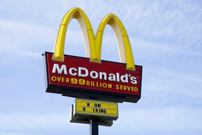 A sign is displayed outside a McDonald's restaurant, Tuesday, April 27, 2021, in Des Moines, Iowa.