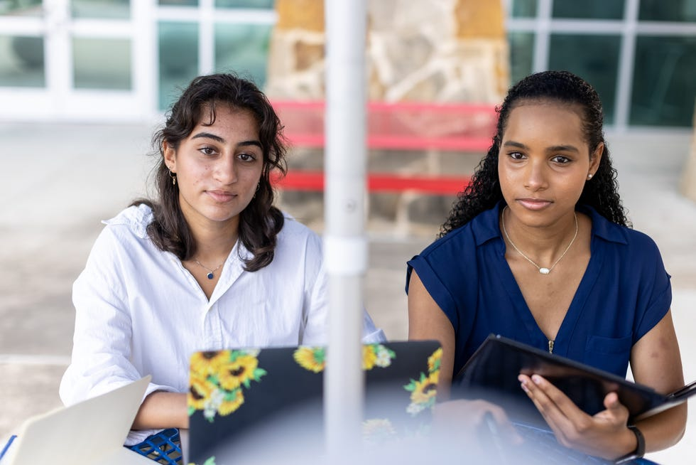 Westlake High School seniors Taarika Bhargava, left, and Mia Jeremiah are members of a student diversity committee seeking to increase communication and celebrate diversity at their school.