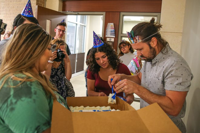 Mano Amiga, a criminal justice reform group, delivered a cake to Hays County District Attorney Wes Mau's office on Thursday to mark the anniversary of what they described as his unfulfilled promise to enact a cite-and-divert program in the county.