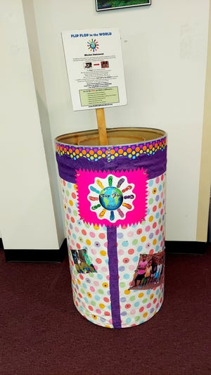 Flip Flop to the World has a donation collection barrel at the Bastrop Public Library.
