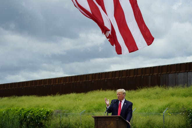 Former President Donald Trump speaks during a visit June 30 to an unfinished section of border wall with Texas Gov. Greg Abbott, in Pharr. [AP PHOTO/ERIC GAY]