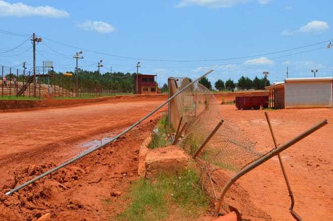 A race car crashed through this chain link fence and killed a man on the infield of the Hartwell Speedway on July 3.