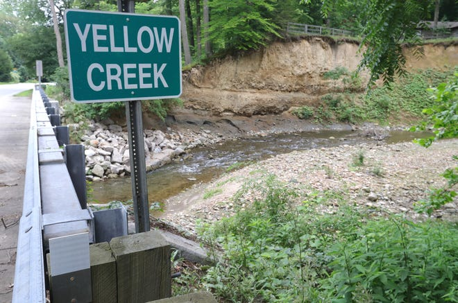 Yellow Creek flows under Yellow Creek Road on Thursday in Bath. An effort to create a watershed conservancy district has been in limbo for years.