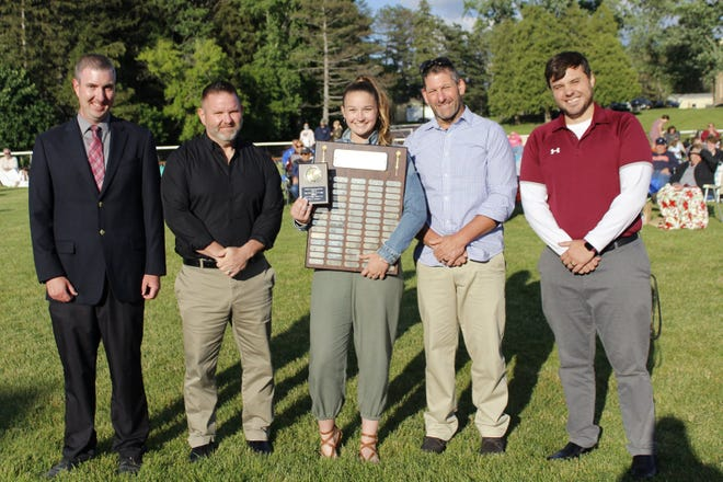 DCS Female Athlete of the Year Hallie Knapp (center) was congratulated by (from left) Athletic Director Scott Shepardson, Coach Sheldon Gibson, Coach Joe Hober, and Coach Michael Strait.