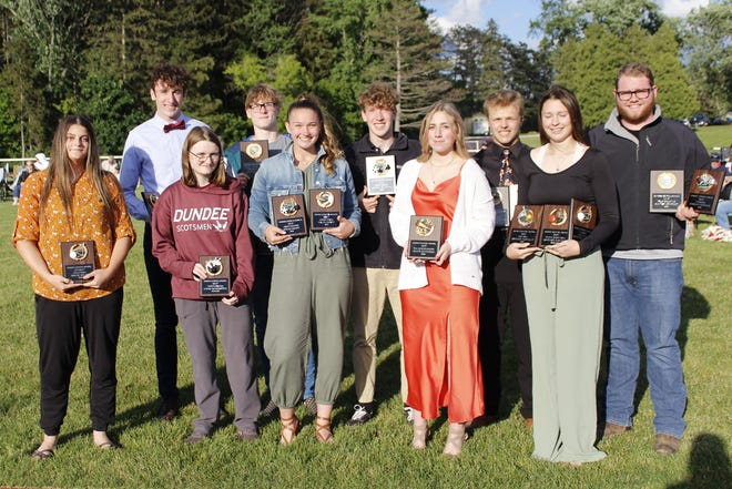 Dundee's Most Valuable Players included from left: Abigail Miller (Volleyball), Steven Webster (Boys Basketball, Boys Track), Cassie Morrissette (Girls Bowling), Camden Buchanan (Cross Country), Hallie Knapp (Girls Soccer, Girls Track), Peyton Boudinot (Boys Soccer), Haley Jefferson (Fall Cheer), Kenneth Empson Jr. (Wrestling), Makenzie Cratsley (Girls Basketball, Softball, Volleyball), Hunter Crofoot (Football, Trap Shooting). Not pictured: Aaron Ayers (Boys Bowling), Colin Snow (Esports).