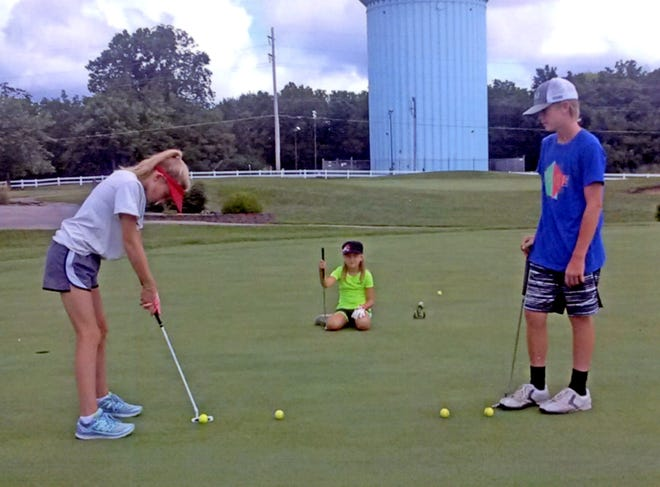 Young golfers practice their putting skills on the large practice green at Green Hills Golf Course.A 2-day youth golf camp will be hosted by GHGC July 28-29.