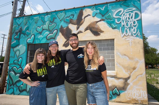 Wild Goose Creative organizers Lydia Simon, executive director, Gabe Michael Kenney, incoming president, Roman Suer, incoming vice-president, and Heather Lynn Kyle, current president, at the new location on McDowell Street in Franklinton. (Photo by Tim Johnson)