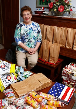 Mary Ann Grove, 70, of Columbus' Indian Hills neighborhood on the city's Northwest Side, helped feed the needy during the pandemic by putting together 100 packages of food each week. So far, she has delivered more than 7,400 snack bags to Holy Family Church.