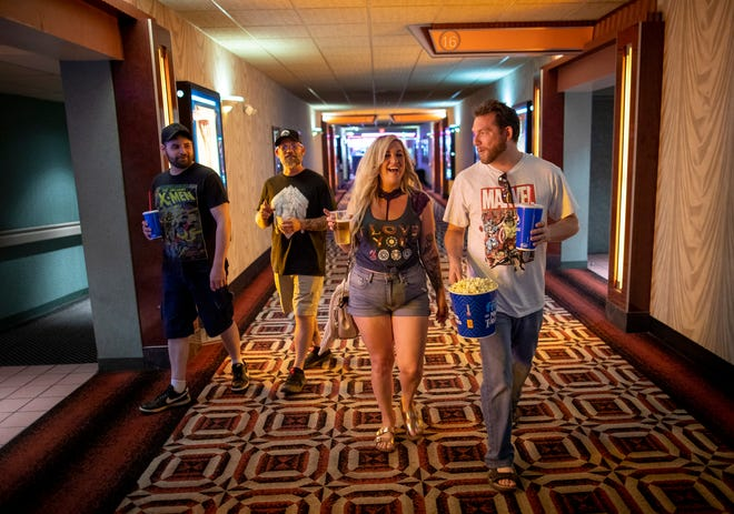 """From left, Jeremy Ramey, Roger Plymale, Jen DeVaughn and Eric DeVaughn, all from Delaware, are eager to see Marvel's """"Black Widow"""" at the Marcus Crosswoods Cinema."""