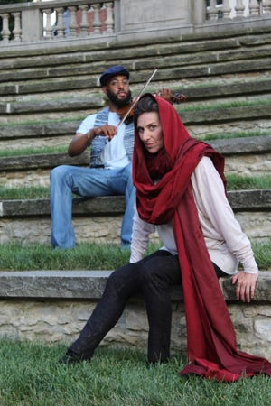 """Stephen Spottswood, left, and Angela Iannone in the CATCO production of """"An Iliad"""" in OSU's Browning Amphitheater."""