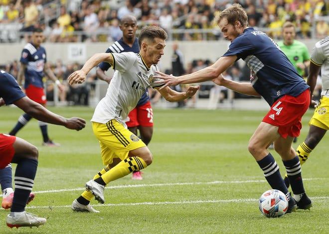 Columbus Crew forward Pedro Santos tries to get past New England defender Henry Kessler on July 3. Santos has yet to score this seasonafter scoring 19 goals the past two seasons.