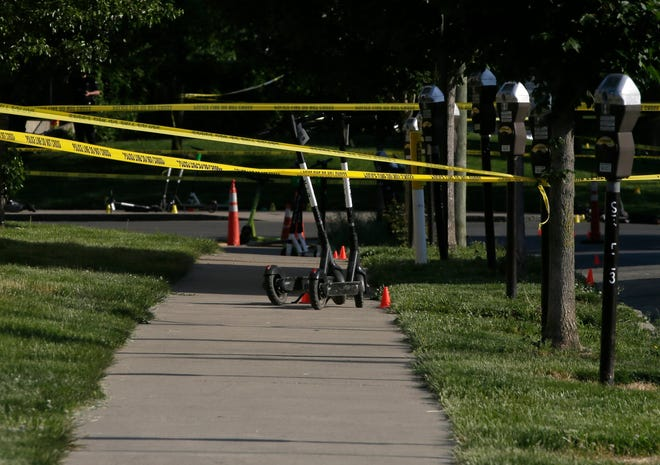 Crime scene tape surrounded Bicentennial Park in downtown Columbus in May, as Columbus police investigated a shooting that killed a 16-year-old girl and injured several other teens.