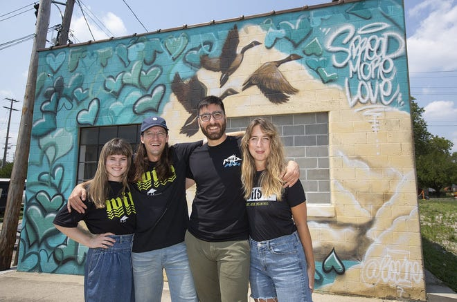 Wild Goose Creative organizers Lydia Simon, executive director; Gabe Michael Kenney, incoming president; Roman Suer, incoming vice-president; and Heather Lynn Kyle, current president at the new location on McDowell Street in Franklinton.