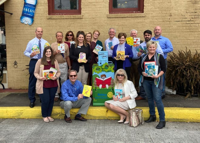 The Houma Rotary Club maintains a Lending Library in downtown Houma to provide books for adults and children.  Members (rear, from left) include Jerry Ledet, Brunnie Bisland, Elmy Savoie, Ashlee Champagne Barahona, Nicole Montiville, Brenda Faucheux, Cal McKey, Kristine Strickland, the Rev. Craig Dalferes, Jay Tipton and Shane Golmon and (front, from left) Katie Portier, Mark Lee, Stephanie Corso and Stacy Solet.