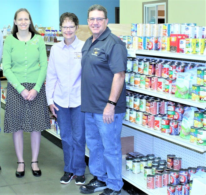Eva Durbin, left is the Millersburg Food Run race coordinator and Polly and Edgar Raber operate the Love Center Food Pantry in Millersburg, which benefits from the Aug. 1 5K, 10K and 1-mile fun run/walk.