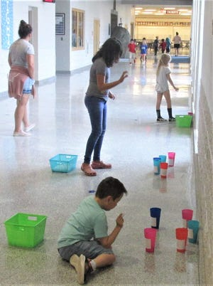 """Elementary students take part in a """"sights word activity"""" at West Holmes High School as their teacher Megan Stryker (far left) watches. West Holmes is one of many school districts in the tri-county area that recently shared back-to-school plans for the fall."""