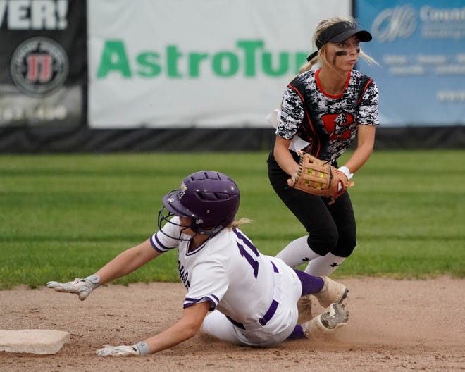 Gold All-Stars' Chloe Houghton (Clinton) tags out Blue All-Stars' Abby Madalinski (Blissfield) as she tries to steal second base during Wednesday night's Lenawee County Senior Softball Showcase.