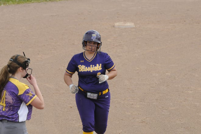 Blissfield's Abby Fisher rounds third base after hitting a home run during a game in the 2021 season.