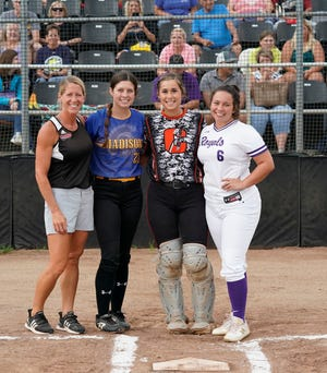 Clinton head coach Kim Phillip (left), Madison's Calie Sower (middle left), Clinton's Libbi Fair (middle right) and Blissfield's Abby Fisher (right) pose for a photo during the 2021 Lenawee County Senior Softball All-Star Showcase at Adrian College.