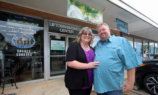 Owners Claudia and David Vaughn pose together outside the Uptown Business Center on East Marion Street in Shelby Thursday morning, July 8, 2021.