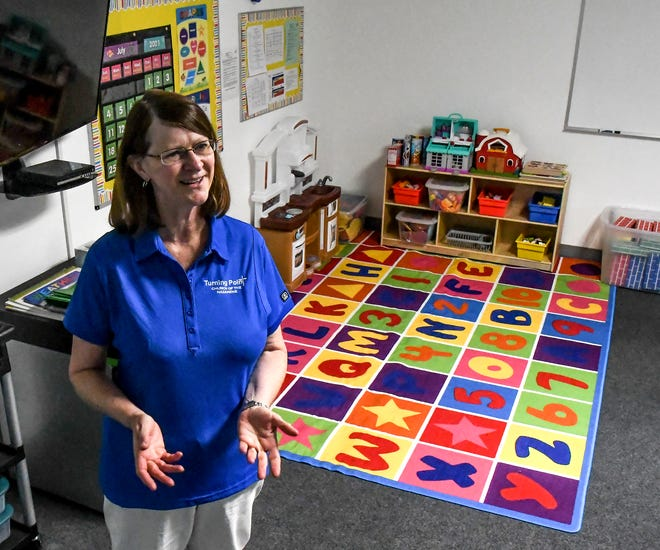 Cindy White talks about her classroom Tuesday with visitors at Turning Point Academy after a ribbon cutting ceremony by the Garden City Area Chamber of Commerce.  The child care facility, located at Turning Point Church of the Nazarene, will be able to handle up to 52 children between six weeks andfive years old.  The facility's officials have finished paperwork for the state and are waiting to receive a temporary license from the Kansas Department of Health and Environment and be open in early August, providing a dent in Garden City's child care shortage.