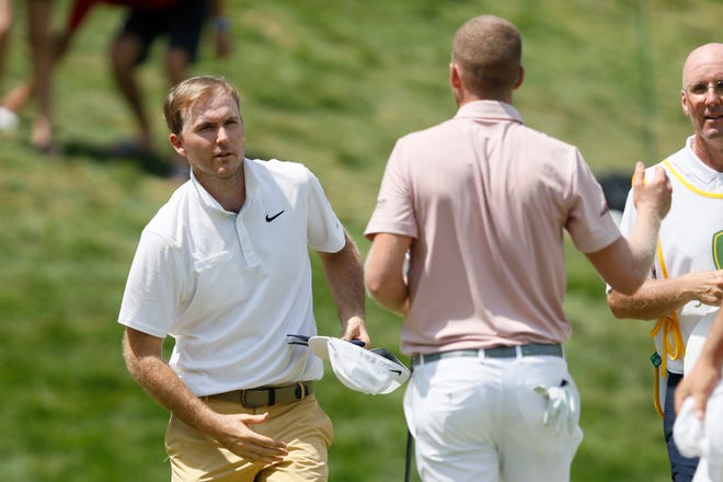 Russell Henley, left, greets Daniel Berger on the 18th green after finishing their final round of the John Deere Classic on Sunday, July 14, 2019, at TPC Deere Run in Silvis.