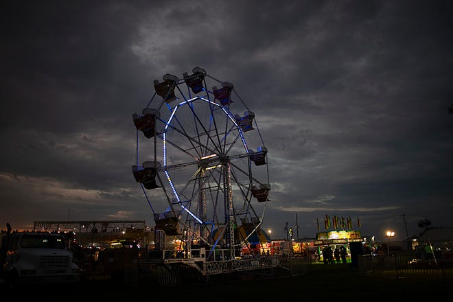 The Knox County Fair midway is silhouetted against a cloudy sky on Wednesday in Knoxville.