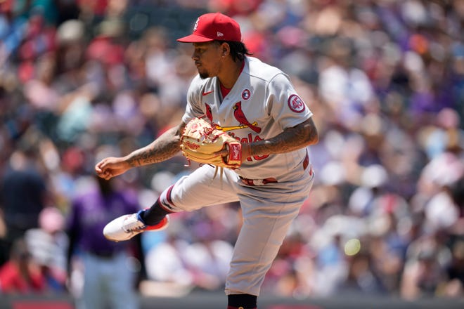 St. Louis Cardinals starting pitcher Carlos Martinez (18) delivers in the third inning of a game on Sunday, July 4, 2021 against the Colorado Rockies in Denver.