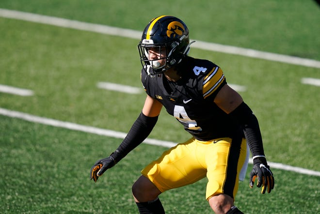 Iowa defensive back Dane Belton gets set for a play during the second half of a game against Michigan State on Saturday, Nov. 7, 2020, in Iowa City, Iowa.