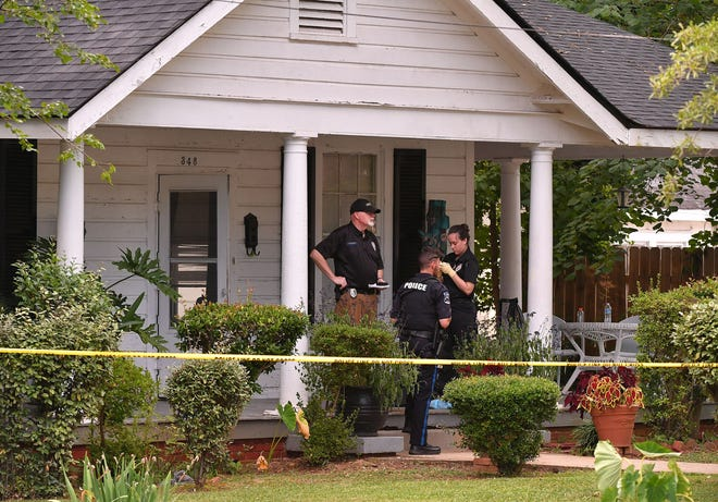 Officers and investigators with the Spartanburg Police Department and the Spartanburg County Coroner's Office are at the scene of the suspicious deaths of two men at 348 Winsmith Avenue, off of Union Street, in Spartanburg, Thursday afternoon, July 8, 2021.
