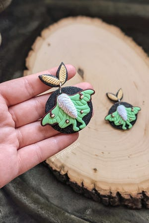 Bloomington artisan Jade Tuper uses polymer clay to create colorful and whimsical jewelry that she markets through her Fairy Ring Studio business.