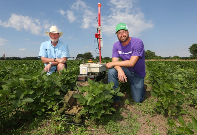 Greenfield Robotics is a company that builds robots that control weeds by cutting them down without tillage and without herbicides, owned by Kansas farmer and CEO Clint Brauer, right, with Jerry Poole, company president and COO.