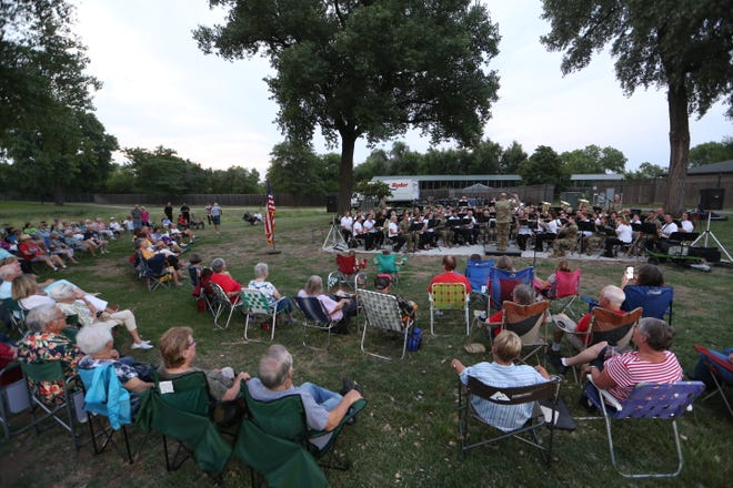More than 100 people listened to the joint performance of the Hutchinson Municipal Band and the Kansas Army National Guard's 35th Infantry Division Band at Carey Park Tuesday night. To see more photos, go to hutchnews.com