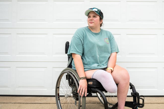 Ashley Green poses for a portrait at her home in Mackinaw on Wednesday, July 7, 2021. Green is the President and Founder of the nonprofit Your Excuse is Invalid, which helps amputees and people with physical disabilities stay active.