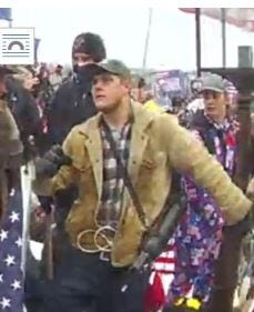Joshua Doolin is seen in an image captured outside the U.S. Capitol on Jan. 6, according to an FBI affidavit.