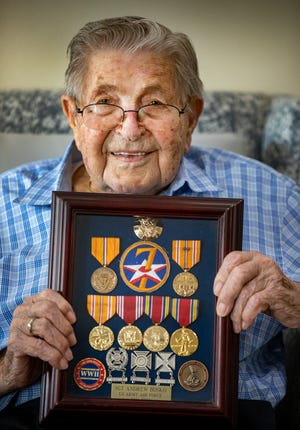 Lake Morton Plaza resident Andy Bosko, an Iwo Jima veteran, holds his medals won in WW II in Lakeland Fl. Wednesday July 7 2021. Lake Morton Plaza threw a birthday party for Andy, who turns 100 on Sunday. ERNST PETERS/ THE LEDGER