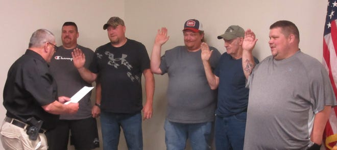 """Elk Garden police chief Jimmy Stewart (left) administered the oath of office to the newly elected town council recently. Taking their oaths were: Michael Droppleman, Jody Paugh, Kevin Broadwater, Dave Tichnell and Donald """"Louie"""" Stewart."""