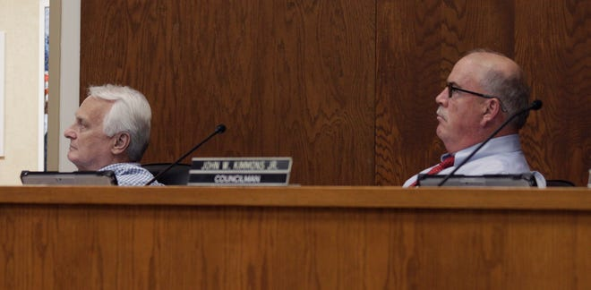 Moberly City Councilman Tim Brubaker and Mayor Jerry Jeffrey look up at a wall screen to watch a Facebook message presentation made by Sean Skellie of Grey Hospitality Consultants during a July 6 city council work session held at City Hall. Skellie shared some early brief findings of a feasibility study concerning a proposed hotel development in downtown Moberly, including his opinion that a limited service hotel should be considered should the city move forward with its proposed plan. A more detailed report will soon be shared with city officials to assist them in making a decision for a 55-room, four story hotel be developed in the 200 block of W. Reed.